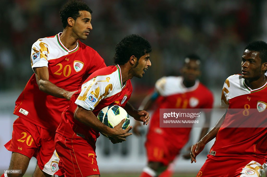 Hussain Ali Hadhri (C) celebrates with teammates after scoring a penalty against Qatar during their 21st Gulf Cup football match in Manama, on January 8, 2013.