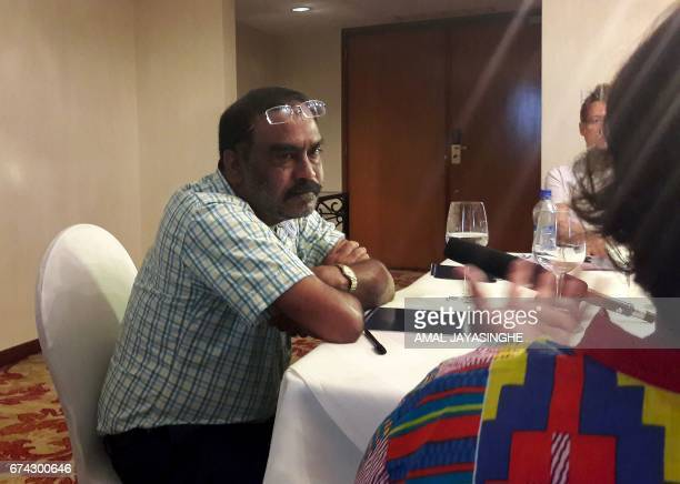Hussain Rasheed the father of slain Maldivian blogger Yameen Rasheed speaks with reporters in Colombo on April 28 2017 The father of the murdered...