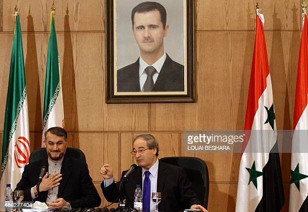 Hussein AmirAbdollahian Iran's deputy Foreign Minister for ArabAfrican Affairs and Syrian deputy Foreign Minister Faisal Moqdad sit under a portrait...