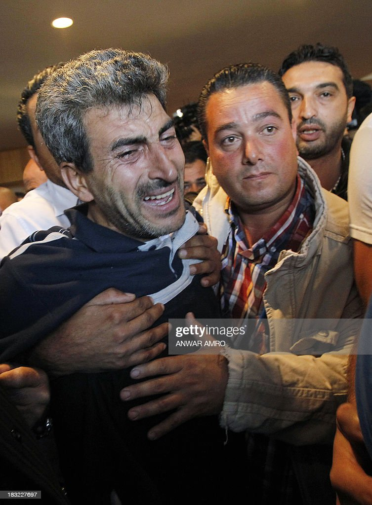 Hussein Khodr, a Lebanese survivor of the migrant shipwreck in Indonesia last week, is welcomed as he arrives at Beirut airport on October 6, 2013. Lebanese asylum-seekers who died when a boat sank off Indonesia were the victims of people smugglers who prey on them and Syrian refugees seeking to better their lives.