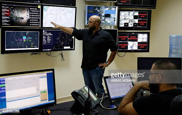 Hussein Nasir alDin points towards a screen at the office of his company Red Crow a startup that monitors security developments and sends realtime...