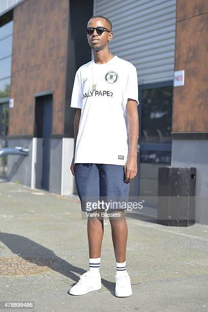 Hussein Suleiman poses wearing a Daily Paper X Nike tshirt Uniqlo pants and K Swiss shoes before the Thom Browne show at the Paris Event Center on...