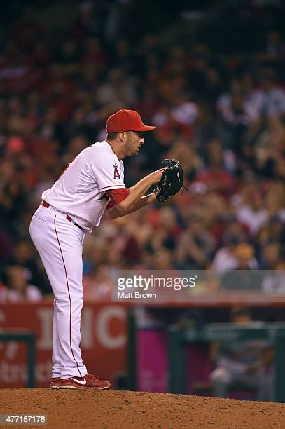 Huston Street of the Los Angeles Angels of Anaheim prepares to pitch during the game against the Detroit Tigers at Angel Stadium of Anaheim on May 30...