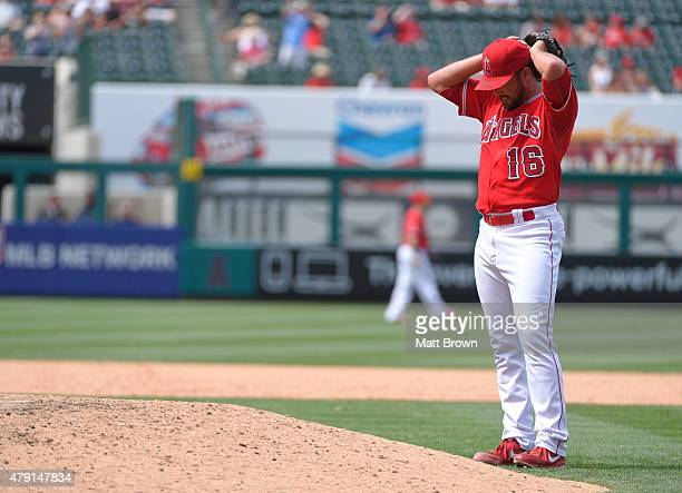 Huston Street of the Los Angeles Angels of Anaheim reacts after allowing a tying home run to Kyle Seager of the Seattle Mariners during the ninth...