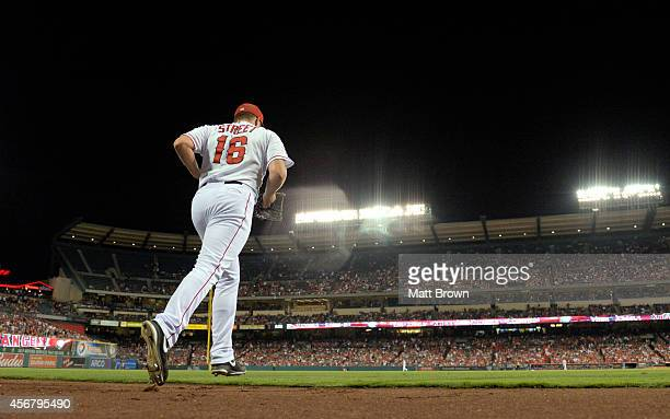 Huston Street of the Los Angeles Angels of Anaheim takes the field during the game against the Texas Rangers on September 20 2014 at Angel Stadium of...