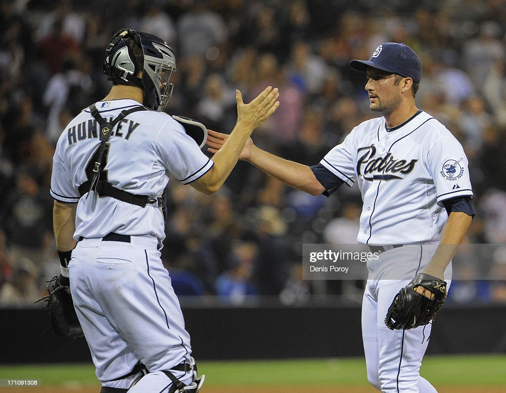 <a gi-track='captionPersonalityLinkClicked' href=/galleries/search?phrase=Huston+Street&family=editorial&specificpeople=212959 ng-click='$event.stopPropagation()'>Huston Street</a> #16 of the San Diego Padres is congratulated by teammate <a gi-track='captionPersonalityLinkClicked' href=/galleries/search?phrase=Nick+Hundley&family=editorial&specificpeople=4175399 ng-click='$event.stopPropagation()'>Nick Hundley</a> #4 after the Padres beat the Los Angeles Dodgers 5-2 during a baseball game at Petco Park on June 21, 2013 in San Diego, California.