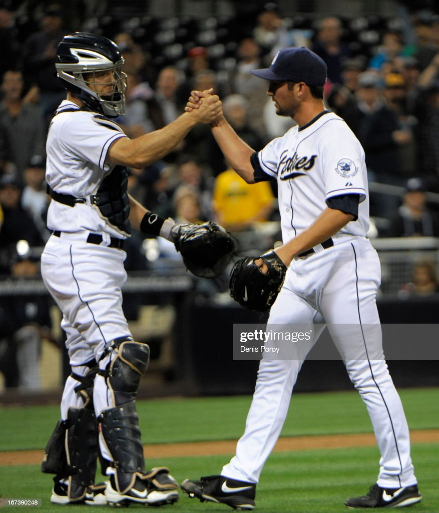 Huston Street #16 of the San Diego Padres, right, is congratulated by Nick Hundley #4 after getting the final out during the ninth inning of a baseball game against the Milwaukee Brewers at Petco Park on April 24, 2013 in San Diego, California. The Padres won 2-1.