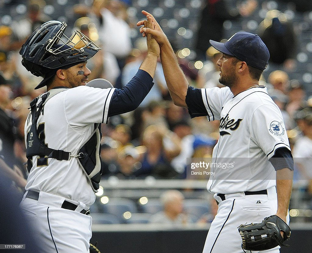 <a gi-track='captionPersonalityLinkClicked' href=/galleries/search?phrase=Huston+Street&family=editorial&specificpeople=212959 ng-click='$event.stopPropagation()'>Huston Street</a> #16 of the San Diego Padres, right, is congratulated by <a gi-track='captionPersonalityLinkClicked' href=/galleries/search?phrase=Rene+Rivera&family=editorial&specificpeople=234850 ng-click='$event.stopPropagation()'>Rene Rivera</a> #44 after getting the final out during the ninth inning of a baseball game against the Pittsburgh Pirates at Petco Park on August 21, 2013 in San Diego, California. The Padres won 2-1.