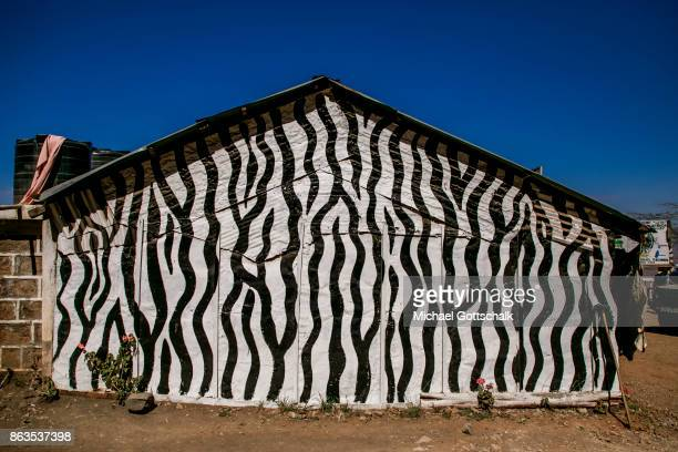 A hut in the colors of a Zebra am Rift Valley View Point Nahe Nairobi on October 08 2017 in Nairobi Kenya