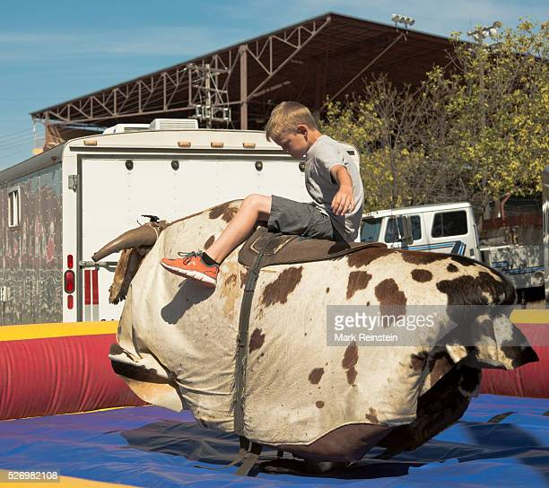 Hutchinson Kansas 9132015 Young boy shows off his rodeo skills on a mechanical bull today at the State Fair in Hutchinson Kansas Credit Mark Reinstein