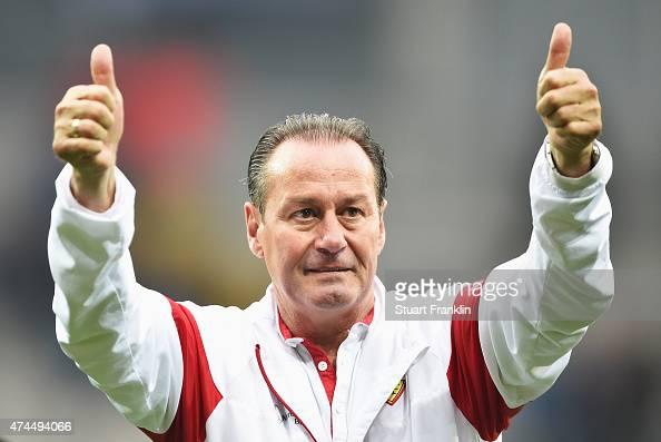 Huub Stevens head coach of Stuttgart celebrates staying in the first Bundesliga after winning the Bundesliga match between SC Paderborn 07 and VfB...