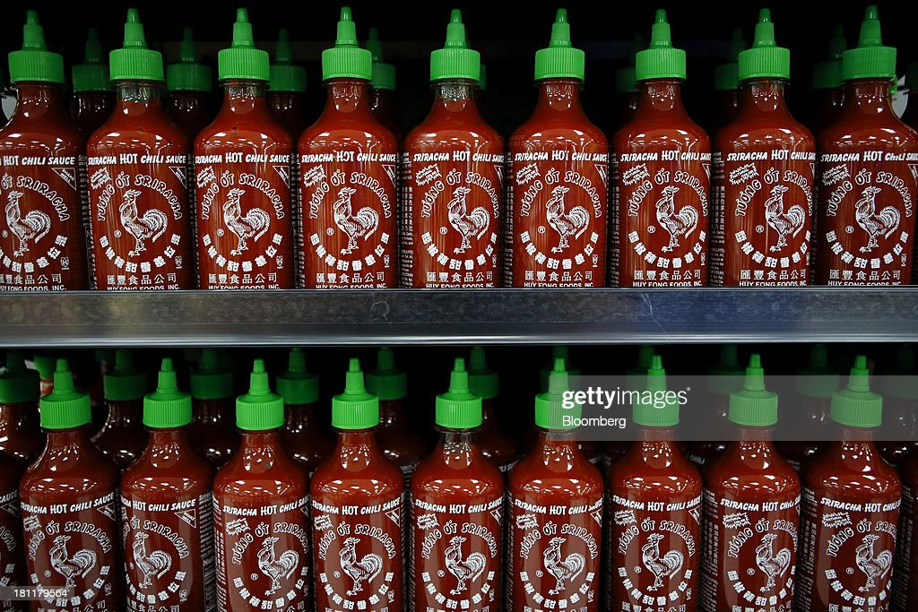 Huy Fong Foods Inc. Sriracha sauce is displayed for sale during the grand opening of a Wal-Mart Stores Inc. location in the Chinatown neighborhood of Los Angeles, California, U.S., on Thursday, Sept. 19, 2013. Wal-Mart Stores Inc. will phase out 10 chemicals it sells in favor of safer alternatives and disclose the chemicals contained in four product categories, the company announced Sept. 12. Photographer: Patrick T. Fallon/Bloomberg via Getty Images