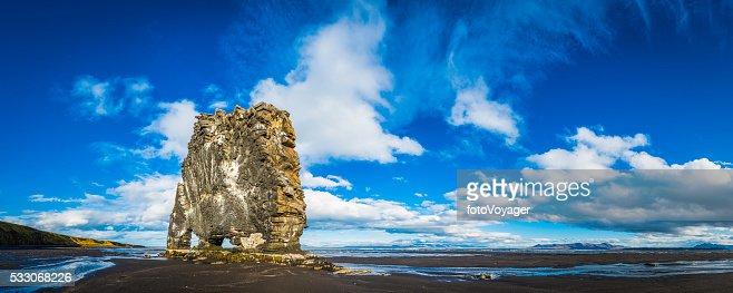 Hvitserkur iconic volcanic sea stack on black beach panorama Iceland