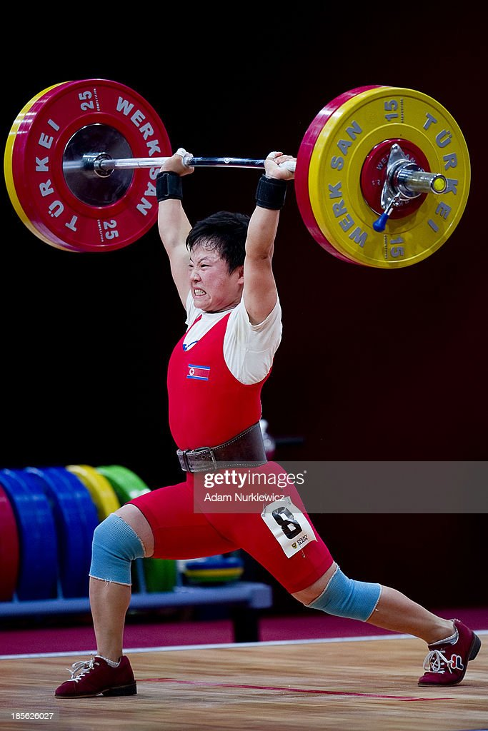 Hwa Chun Ryang from North Korea lifts in the Clean and Jerk competition during the women's 48 kg Group A weightlifting IWF World Championships Wroclaw 2013 at Centennial Hall on October 20, 2013 in Wroclaw, Poland.