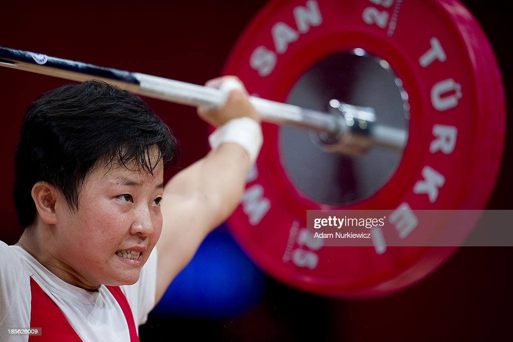 Hwa Chun Ryang from North Korea lifts in the women's snatch competition during the 48 kg Group A weightlifting IWF World Championships Wroclaw 2013 at Centennial Hall on October 20, 2013 in Wroclaw, Poland.
