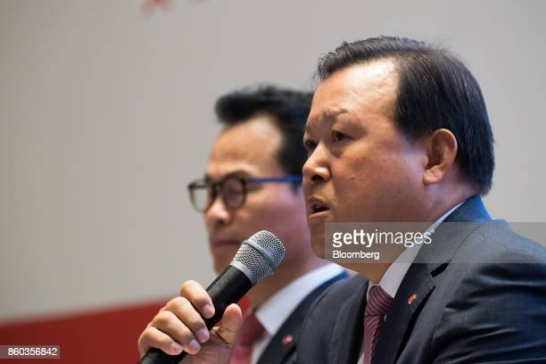 Hwang Kaggyu cheif executive officer of Lotte Corp right speaks during a news conference in Seoul South Korea on Thursday Oct 12 2017 Lotte Group...