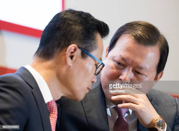 Hwang Kaggyu cheif executive officer of Lotte Corp right speaks with Lim Byungyun executive vice president during a news conference in Seoul South...