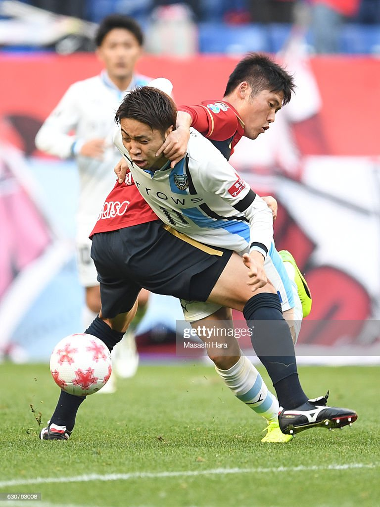 Hwang Seok Ho of Kashima Antlers and Yu Kobayashi of Kawasaki Frontale compete for the ball during the 96th Emperor's Cup final match between Kashima Antlers and Kawasaki Frontale at Suita City Football Stadiumon January 1, 2017 in Suita, Osaka, Japan.