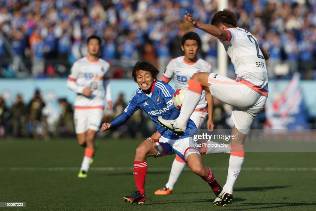 Hwang Seok Ho (R) of Sanfrecce Hiroshima and Shingo Hyodo of Yokohama F.Marinos compete for the ball during the 93rd Emperor's Cup final between Yokohama F.Marinos and Sanfrecce Hiroshima at the National Stadium on January 1, 2014 in Tokyo, Japan.