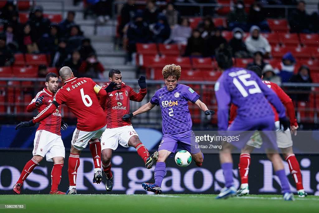 Hwang Seokho (C) of Sanfrecce Hiroshima challenges Gedo of Al-Ahly SC during the FIFA Club World Cup Quarter Final match between Sanfrecce Hiroshima and Al-Ahly SC at Toyota Stadium on December 9, 2012 in Toyota, Japan.