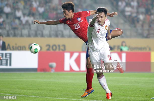 Hwang SeokHo of South Korea competes for the ball with Gao Lin of China during the EAFF East Asian Cup match between Korea Republic and China at...