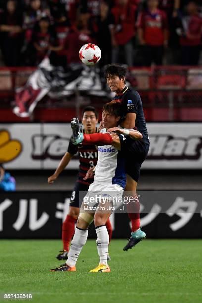 Hwang Ui Jo of Gamba Osaka and Shuto Yamamoto of Kashima Antlers compete for the ball during the JLeague J1 match between Kashima Antlers and Gamba...