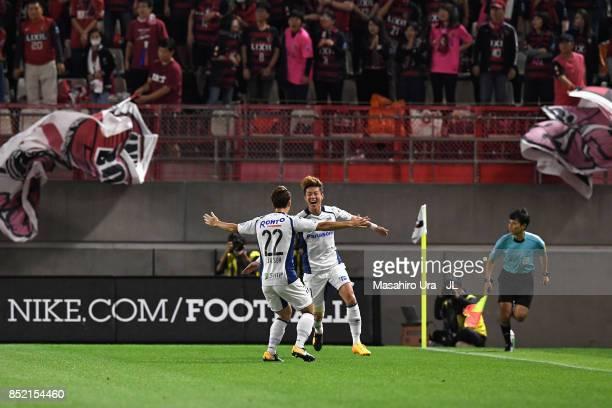 Hwang Ui Jo of Gamba Osaka celebrates scoring his side's first goal with Oh Jae Suk of Gamba Osaka during the JLeague J1 match between Kashima...