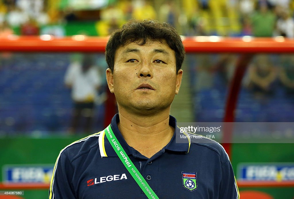 Hwang Yong Bong, head coach of Korea DPR looks on before the FIFA U-20 Women's World Cup 2014 3rd place playoff match between Korea DPR and France at Olympic Stadium on August 24, 2014 in Montreal, Canada.