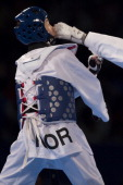 HwiLang Kim of Korea competes with Marina Sumic of Croatia during a women's 62 kg combat of WTF World Taekwondo Championships 2013 at the exhibitions...