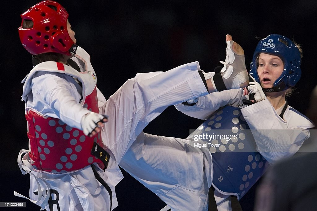 Hwi-Lang Kim of Korez competes with Nina Klaey of Switzerland women's -62 kg final combat of WTF World Taekwondo Championships 2013 at the exhibitions Center on July 21, 2013 in Puebla, Mexico.