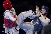 HwiLang Kim of Korez competes with Nina Klaey of Switzerland women's 62 kg final combat of WTF World Taekwondo Championships 2013 at the exhibitions...