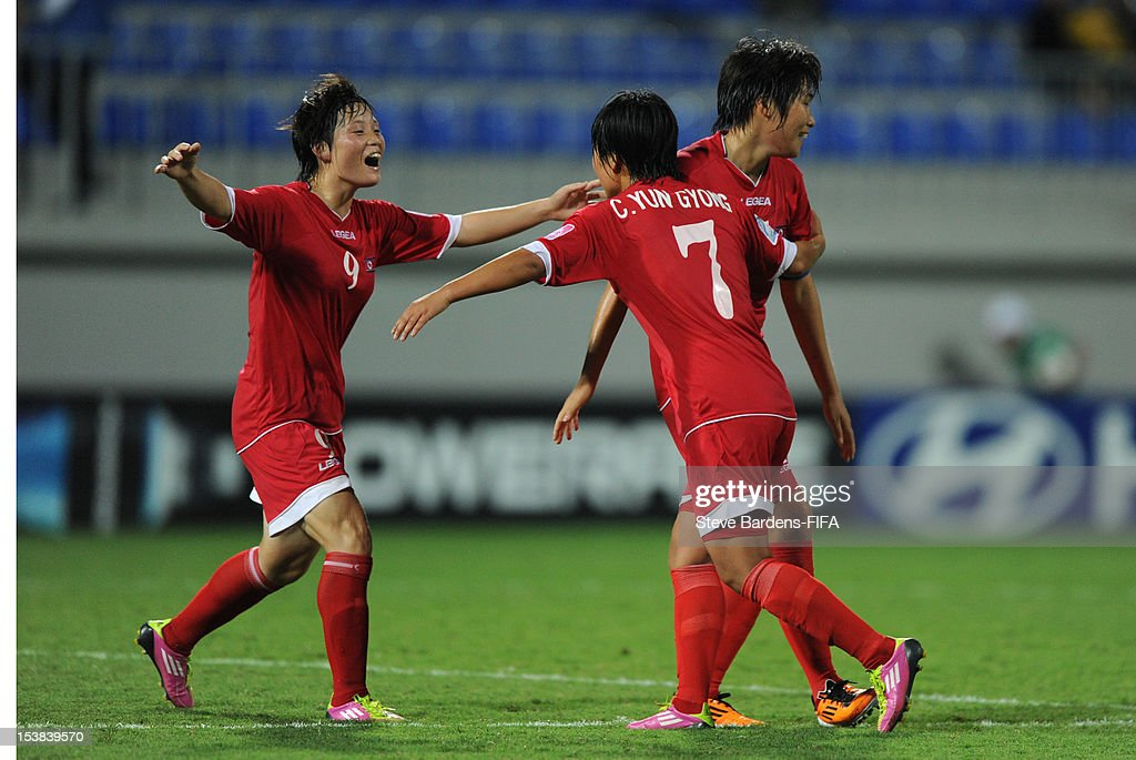 Hyang Sim Ri, Yun Gyong Choe and Chung Bok Choe of Korea DPR celebrate victory at the final whistle of the FIFA U-17 Women's World Cup 2012 Semi-Final match between Korea DPR and Germany at 8KM Stadium on October 9, 2012 in Baku, Azerbaijan.