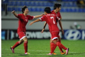 Hyang Sim Ri Yun Gyong Choe and Chung Bok Choe of Korea DPR celebrate victory at the final whistle of the FIFA U17 Women's World Cup 2012 SemiFinal...