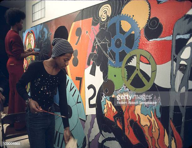 Hyde Park high school students work on a mural project overseen by Mitchell Caton at the Museum of Science and Industry to coincide with the Black...