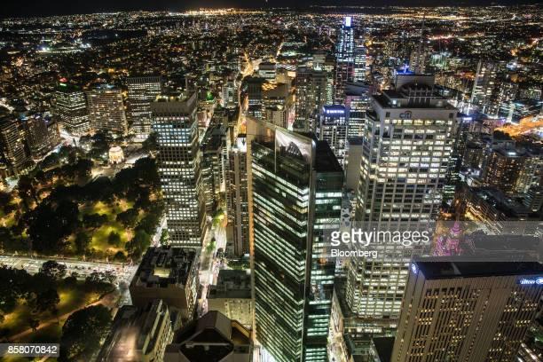 Hyde Park left and buildings in the financial district stand illuminated at night in Sydney Australia on Friday Sept 29 2017 A bungled transition...