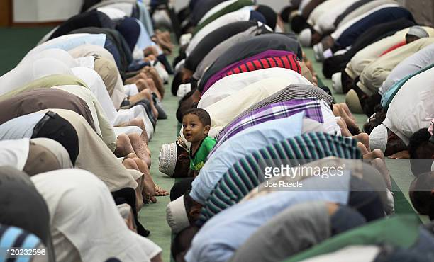 Hyder Huzri waits as his father and others pray during an evening prayer on the first day of Ramadan at the Islamic Center of Greater Miami on August...