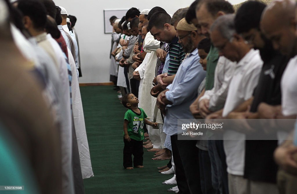 Hyder Huzri, 2, waits as his father and others pray during an evening prayer on the first day of Ramadan at the Islamic Center of Greater Miami on August 1, 2011 in Miami, Florida. Worlwide Muslims honor Ramadan with the sighting of the new moon and is marked with fasting each morning at dawn and ends in the evening at dusk of each day for the next month, culminating in the three-day Eid ul-Fitr celebration
