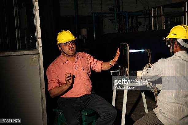 Hyderabad Andhra Pradesh India Pallava Bagla testing the heat resistant material used on the missile reentry with a welding or blow torch on one side...