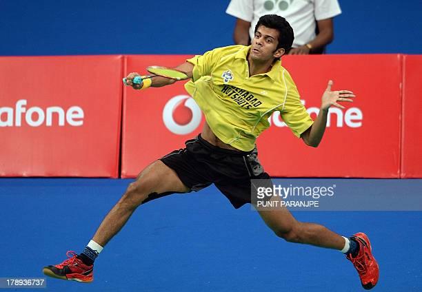 Hyderabad Hotshots player Ajay Jayaram plays a shot during the singles badminton match against Awadhe Warriors Guru Sai Dutt during the finals of...