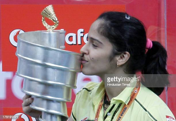 Hyderabad Hotshots player Saina Nehwal with Badminton League Champion 2013 trophy after winning the final match against Awadhe Warriors in the Indian...
