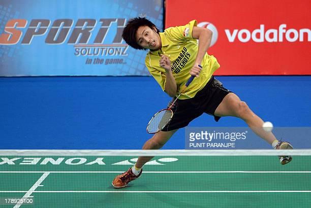 Hyderabad Hotshots player Tanongsak Saemsomboonsuk plays a shot during a badminton match against Awadhe Warriors K Shrikanth during the finals of...