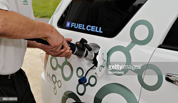 A hydrogen refueling hose is connected to a Chevrolet Equinox fuel cell electric vehicle outside Air Products Chemicals Inc headquarters in Allentown...