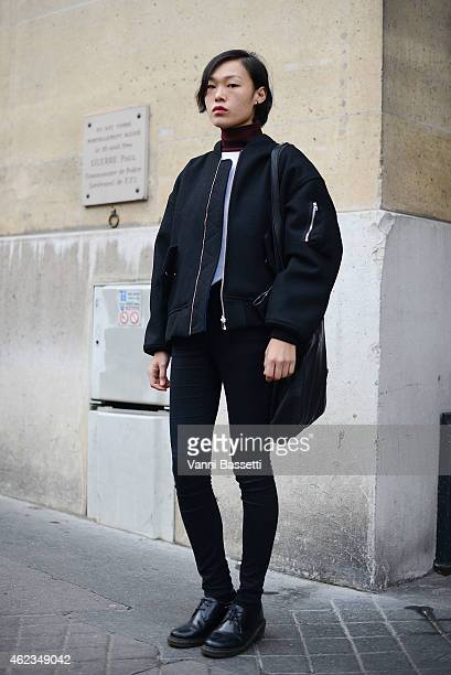 Hye Seon Jeong poses wearing Etudes bomber and bag during day 3 of Paris Haute Couture Spring Summer 2015 on January 27 2015 in Paris France