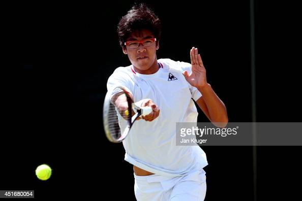 Hyeon Chung of Korea during his Boys' Singles QuarterFinal against Stefan Kozlov of the United States on day eleven of the Wimbledon Lawn Tennis...