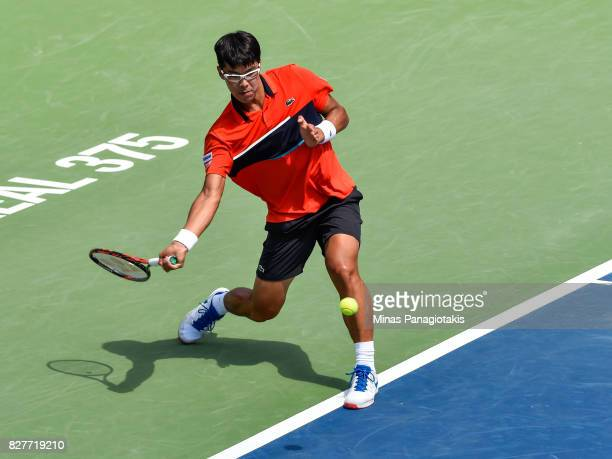 Hyeon Chung of Korea hits a return shot against Feliciano Lopez of Spain during day five of the Rogers Cup presented by National Bank at Uniprix...