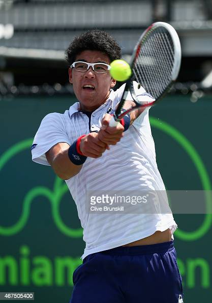 Hyeon Chung of Korea plays a backhand against Marcel Granollers of Spain in their first round match during the Miami Open at Crandon Park Tennis...