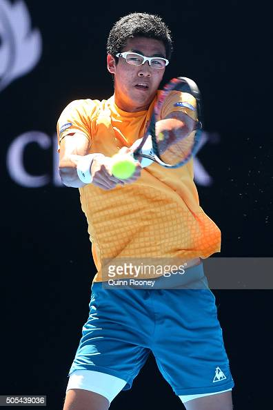 Hyeon Chung of Korea plays a backhand in his first round match against Novak Djokovic of Serbia during day one of the 2016 Australian Open at...