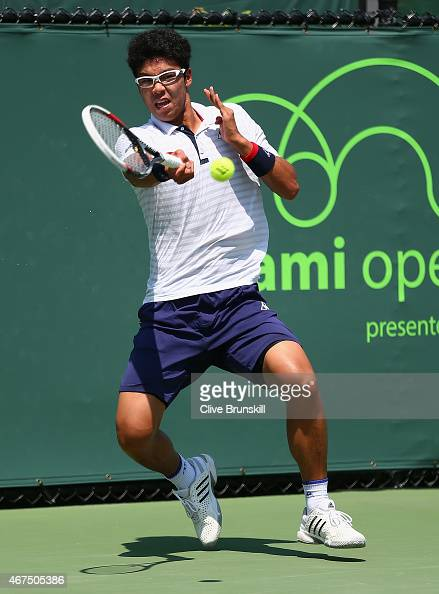 Hyeon Chung of Korea plays a forehand against Marcel Granollers of Spain in their first round match during the Miami Open at Crandon Park Tennis...