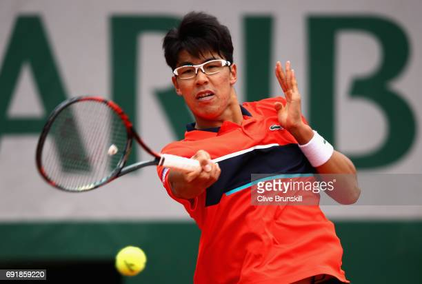 Hyeon Chung of Korea plays a forehand during the mens singles third round match against Kei Nishikori of Japan on day seven of the 2017 French Open...