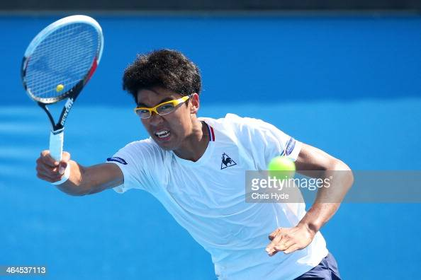 Hyeon Chung of Korea plays a forehand in his quarterfinal match against Alexander Zverev of Germany during the 2014 Australian Open Junior...